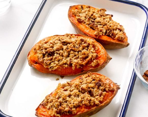Three mini sweet potato casserole boats with crumble and pecans.