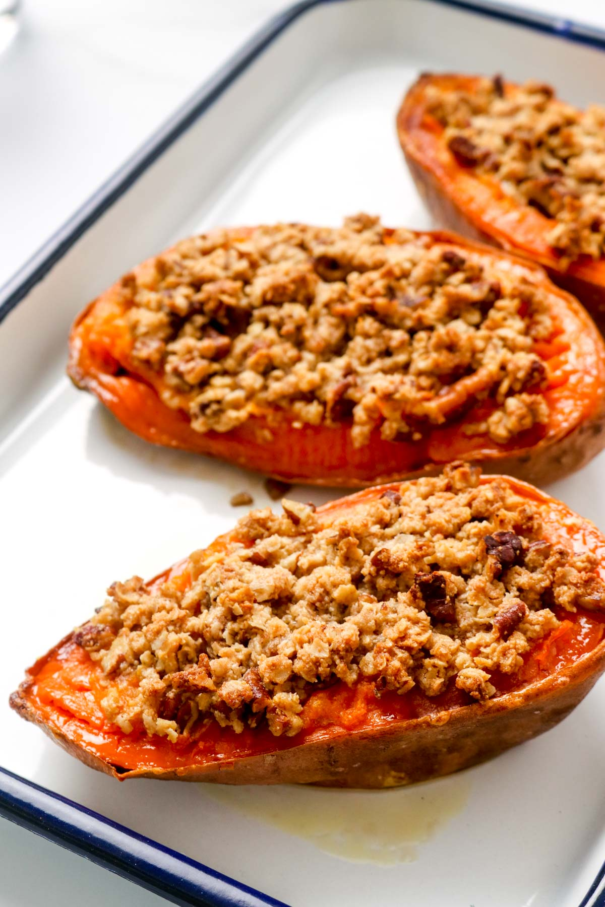 Three mini sweet potato casserole boats with crumble.