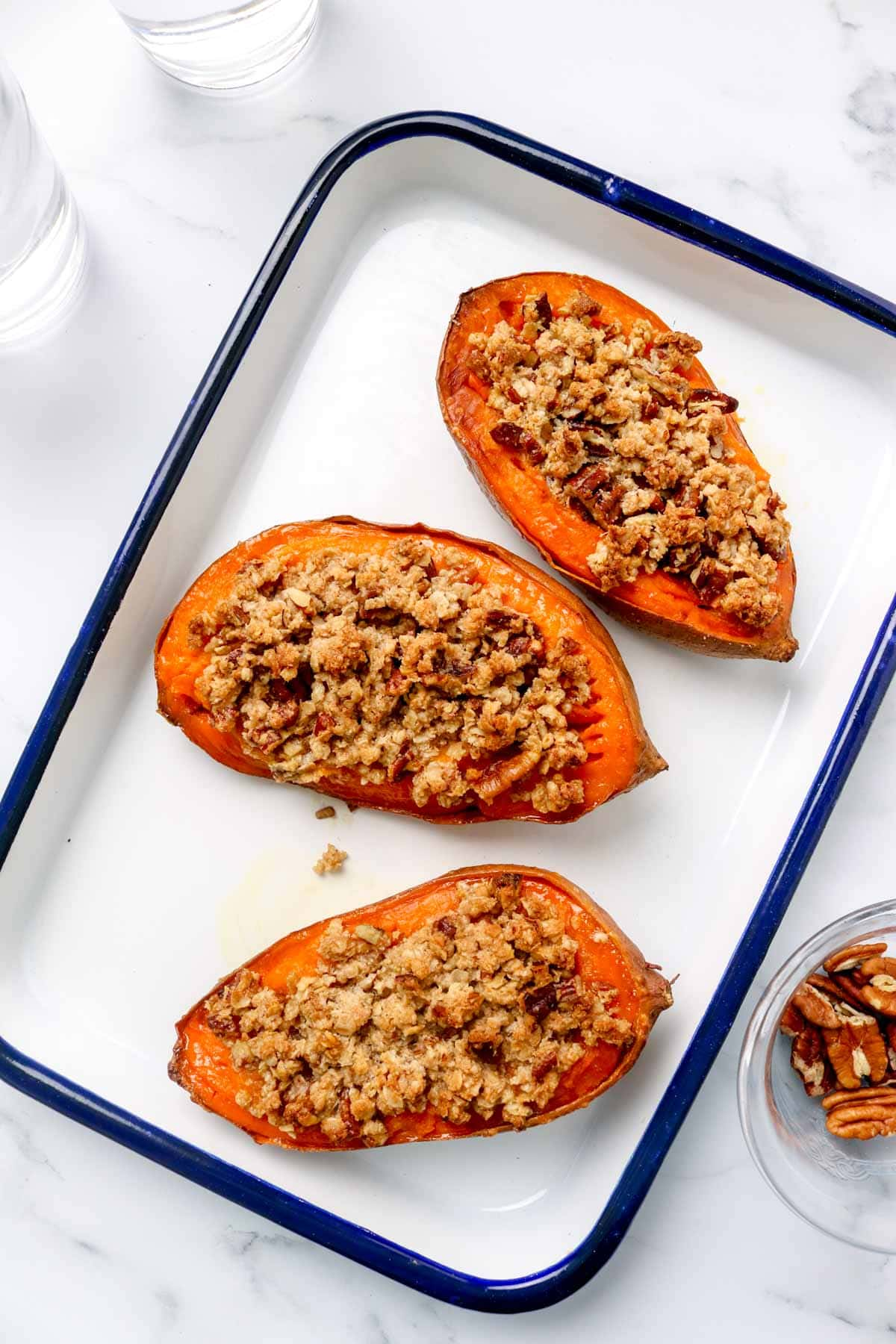 Three mini sweet potato casserole boats with streusel and pecans.