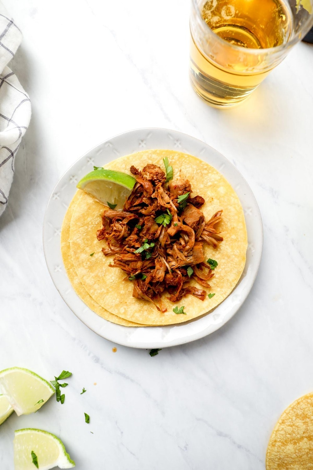 Beer Braised Jackfruit Tacos with lime and cilantro.