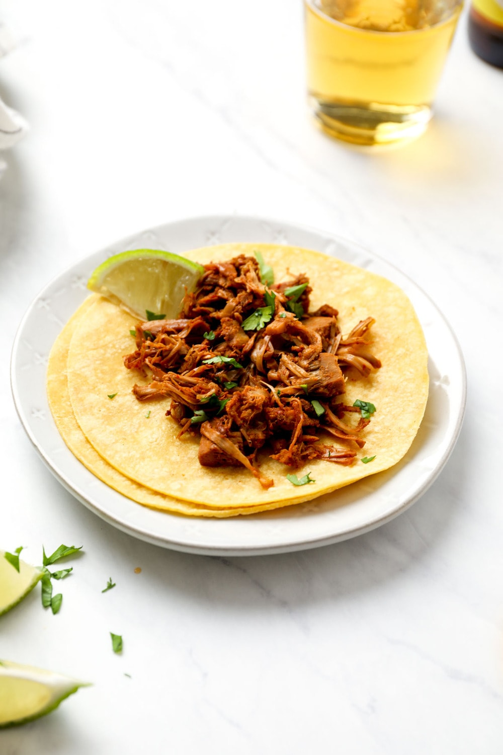 Beer Braised Jackfruit Tacos in corn tortillas with lime.