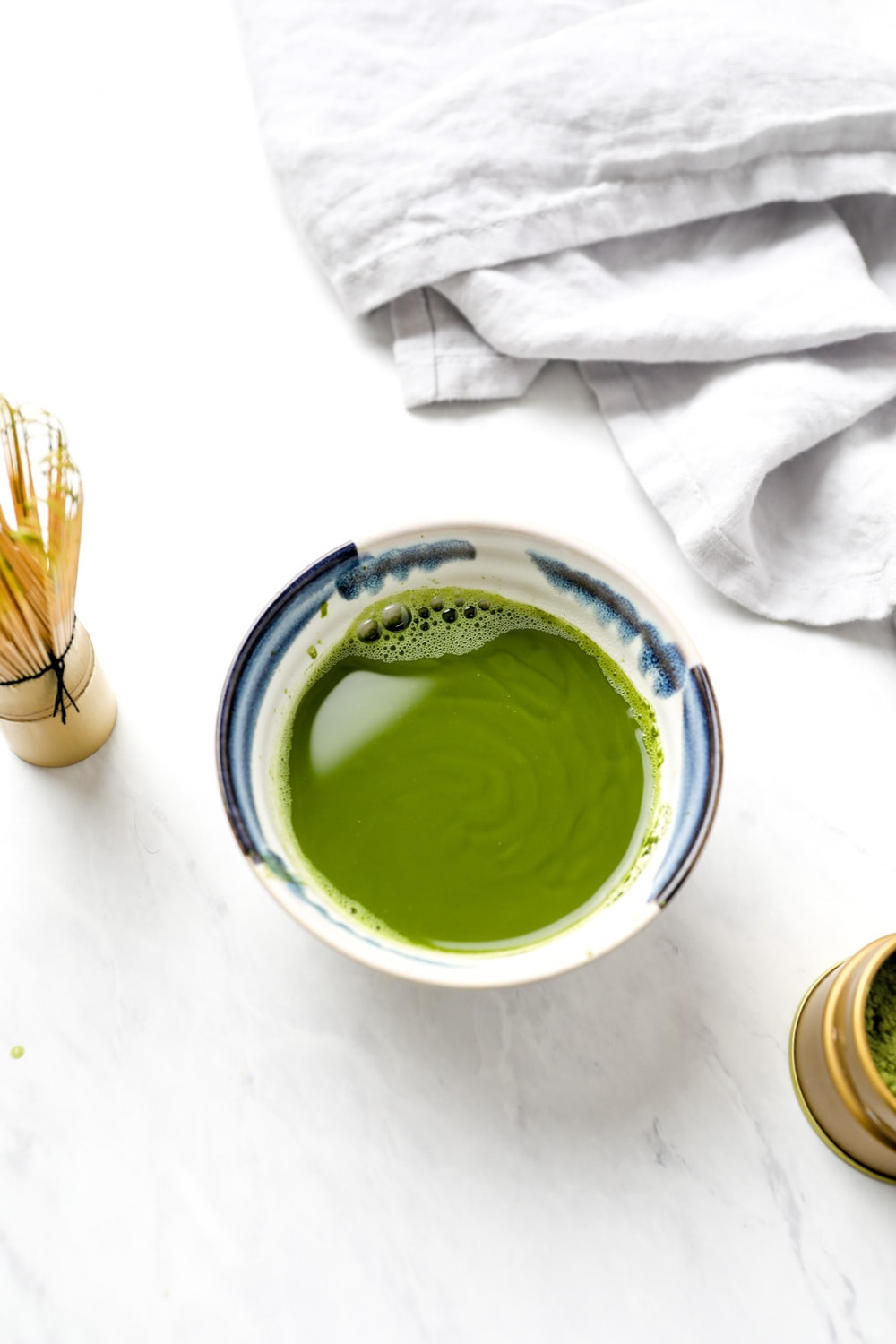 Matcha and water in a matcha bowl.