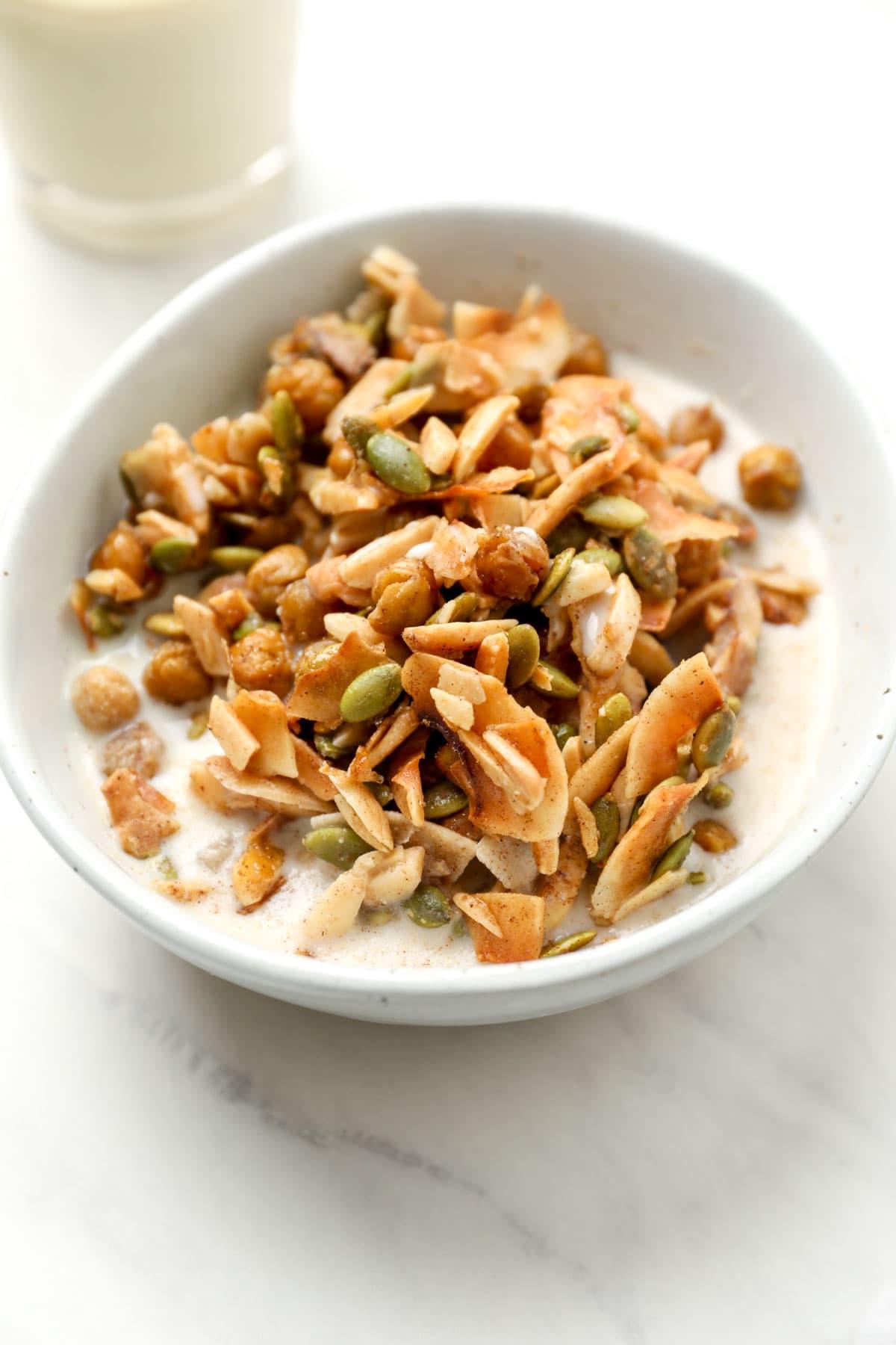 A bowl of vegan grain free granola with coconut.