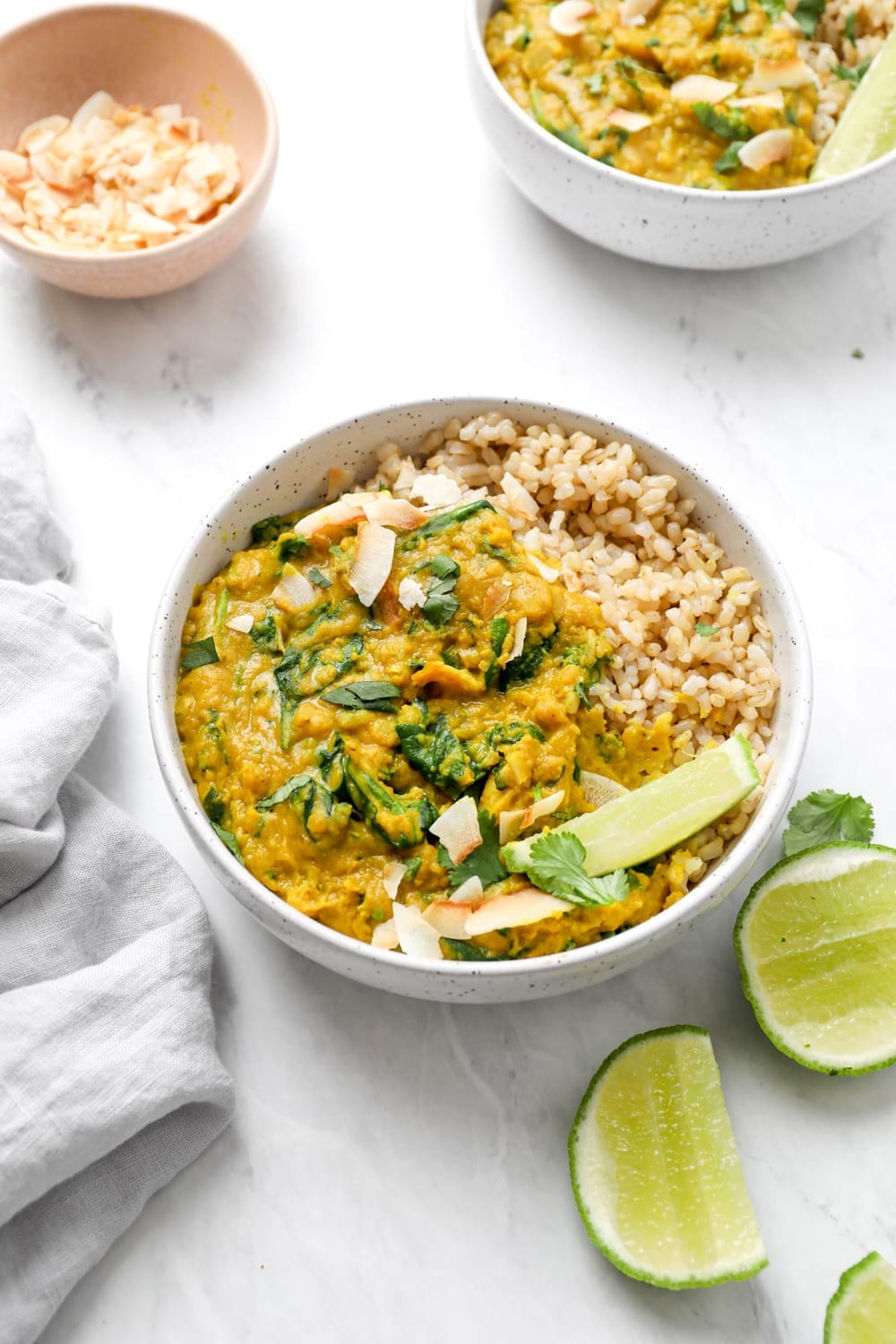 A bowl of instant pot red lentil curry with coconut and lime.