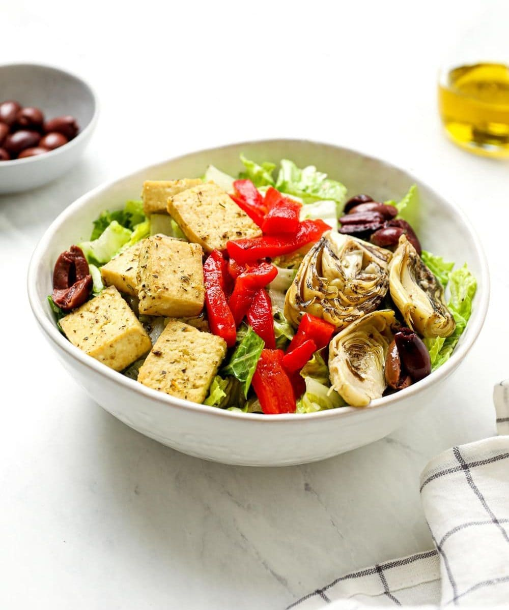 Italian chef salad with kalamata olives, and vegan lemon herb baked tofu.