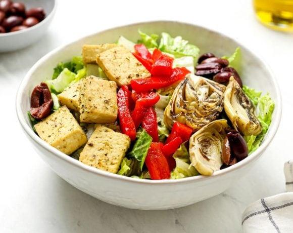 Italian chef salad with kalamata olives, and vegan lemon herb baked tofu.