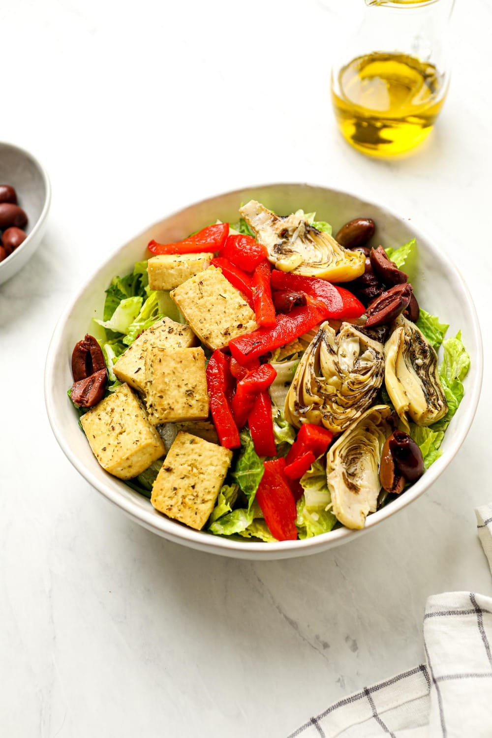 Italian chef salad with olives, peppers, tofu, and olive oil dressing.