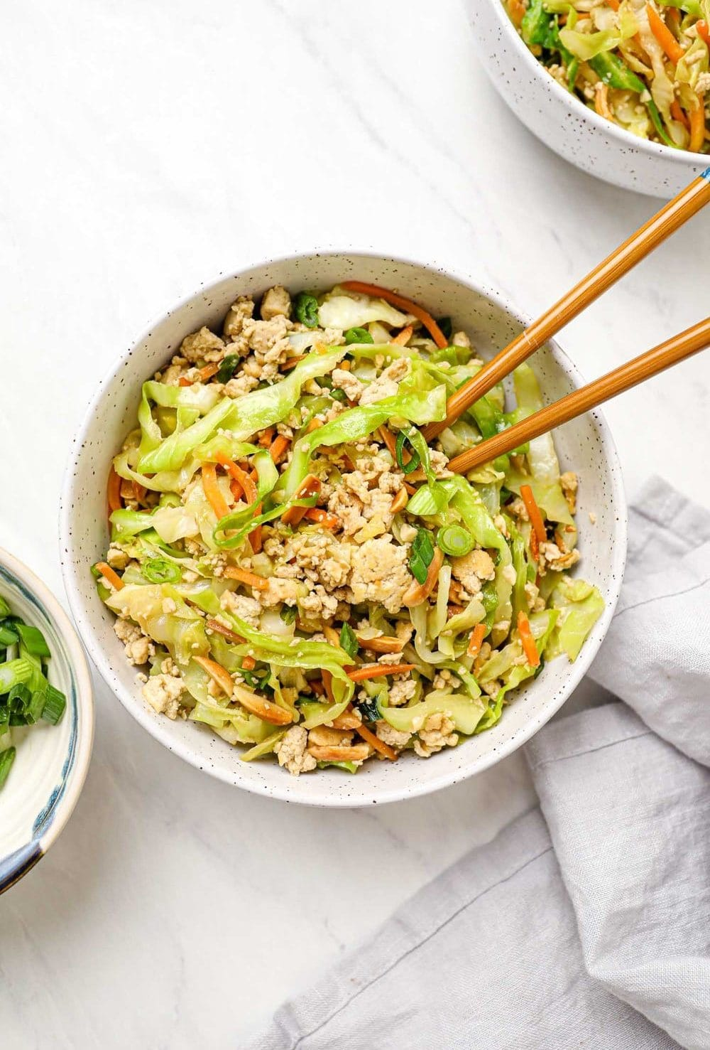 Vegan Egg Roll in a Bowl with cabbage and scallions.