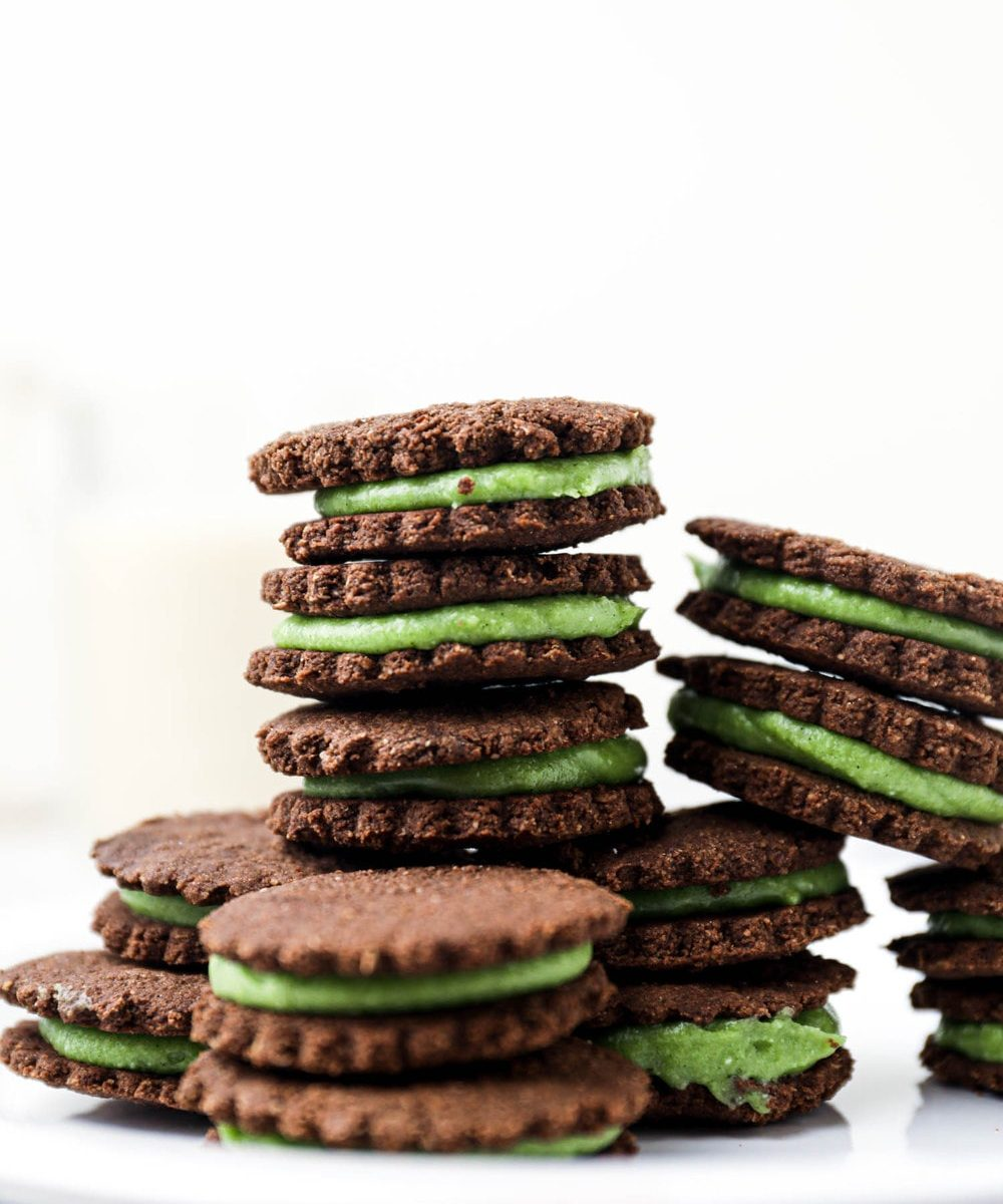 Stacked vegan and gluten free mint oreos.