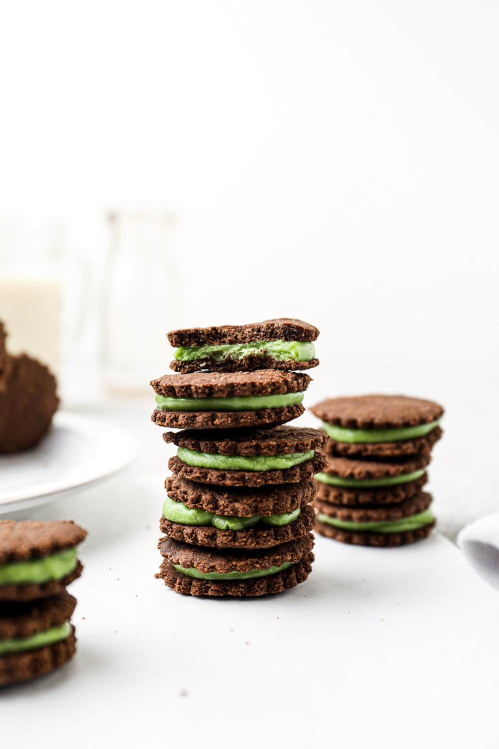 A stack of vegan oreos with mint filling.