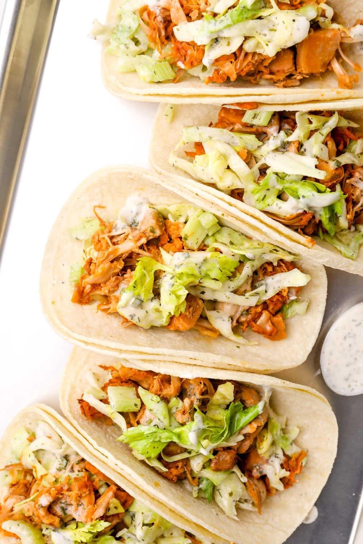 Buffalo jackfruit tacos with corn tortillas and celery slaw.