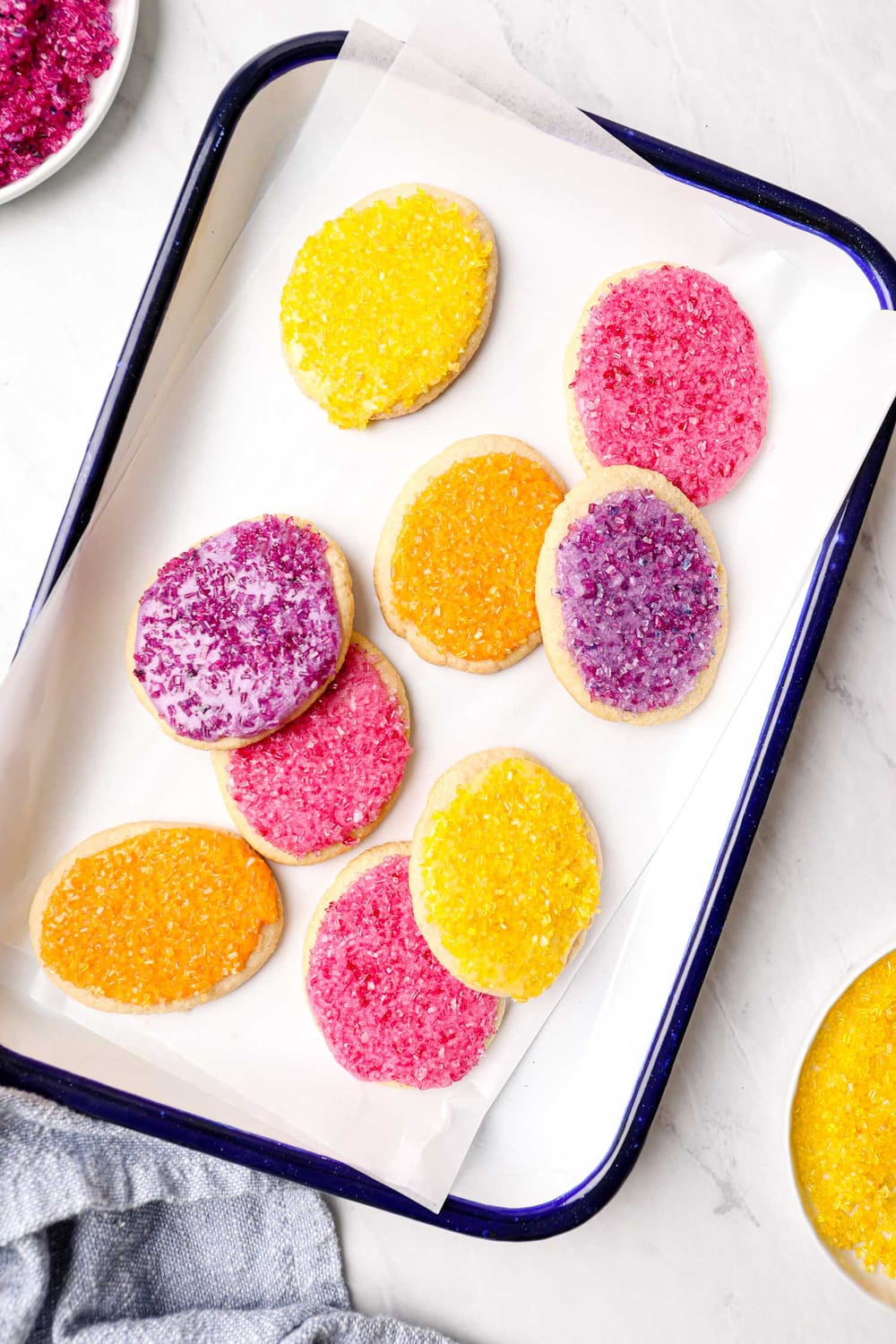 A plate of frosted grain free easter egg sugar cookies.