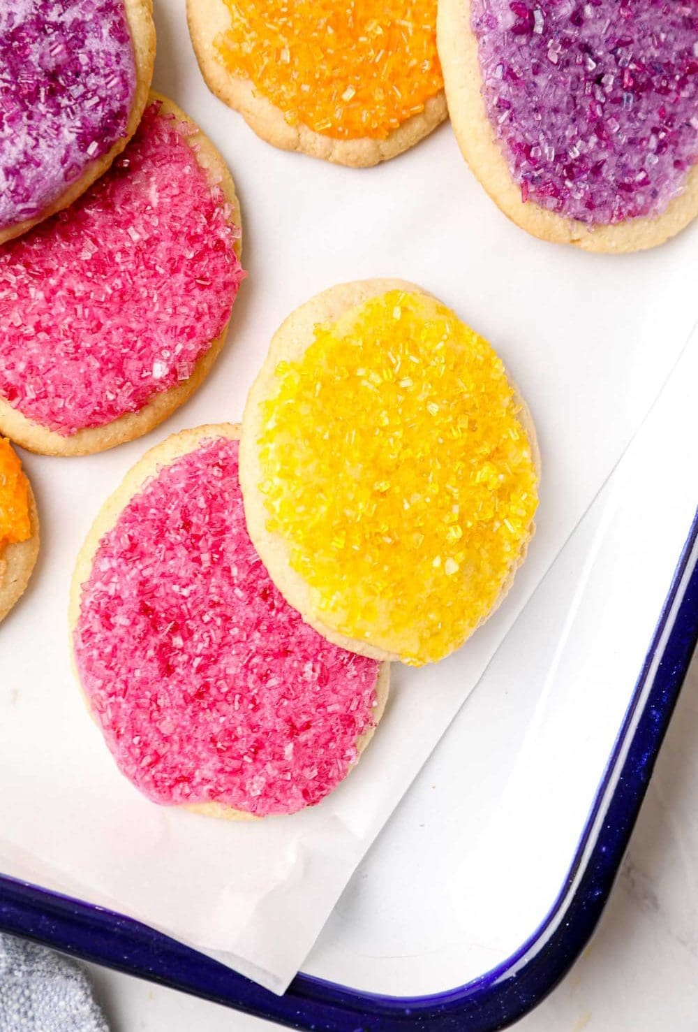 Grain free Easter egg sugar cookies with frosting and sprinkles.