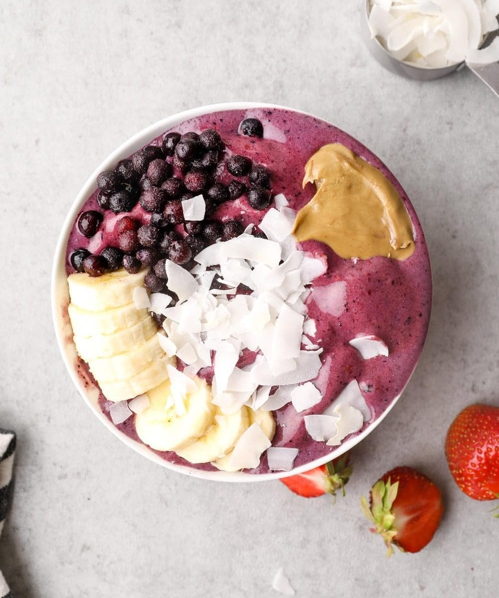 A protein smoothie bowl with toppings.