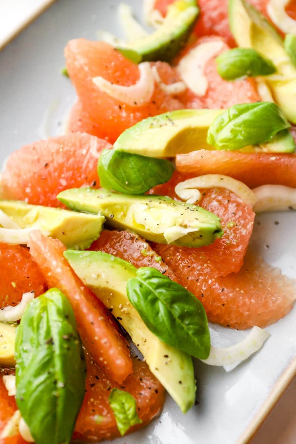 Grapefruit Avocado Salad with fennel and basil on a serving plate.