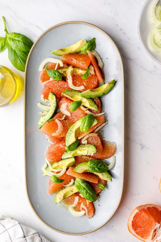 Grapefruit Avocado Salad arranged on a serving platter