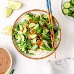 Vegan Summer Roll in a Bowl with cucumbers, herbs, and peanut sauce.