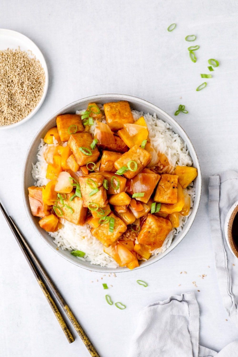 Healthy Sweet and Sour Sauce cooked with tofu, pineapple, and peppers.