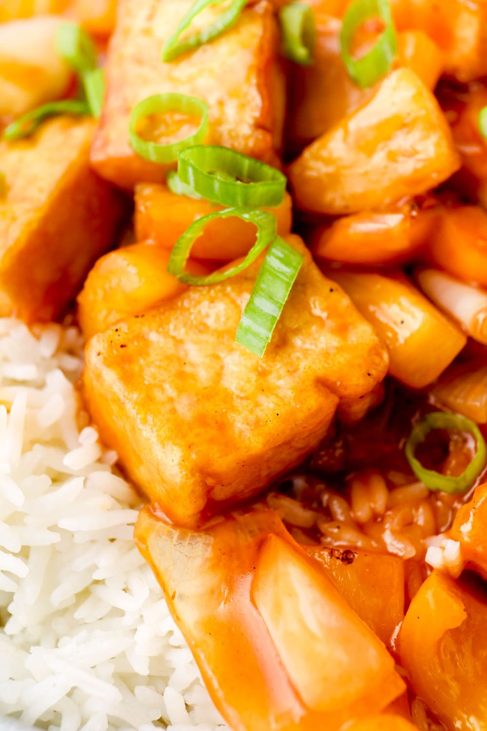 Sweet and Sour Tofu with scallions over rice.