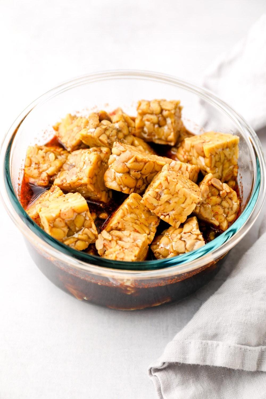 Tofu sitting in a marinade.