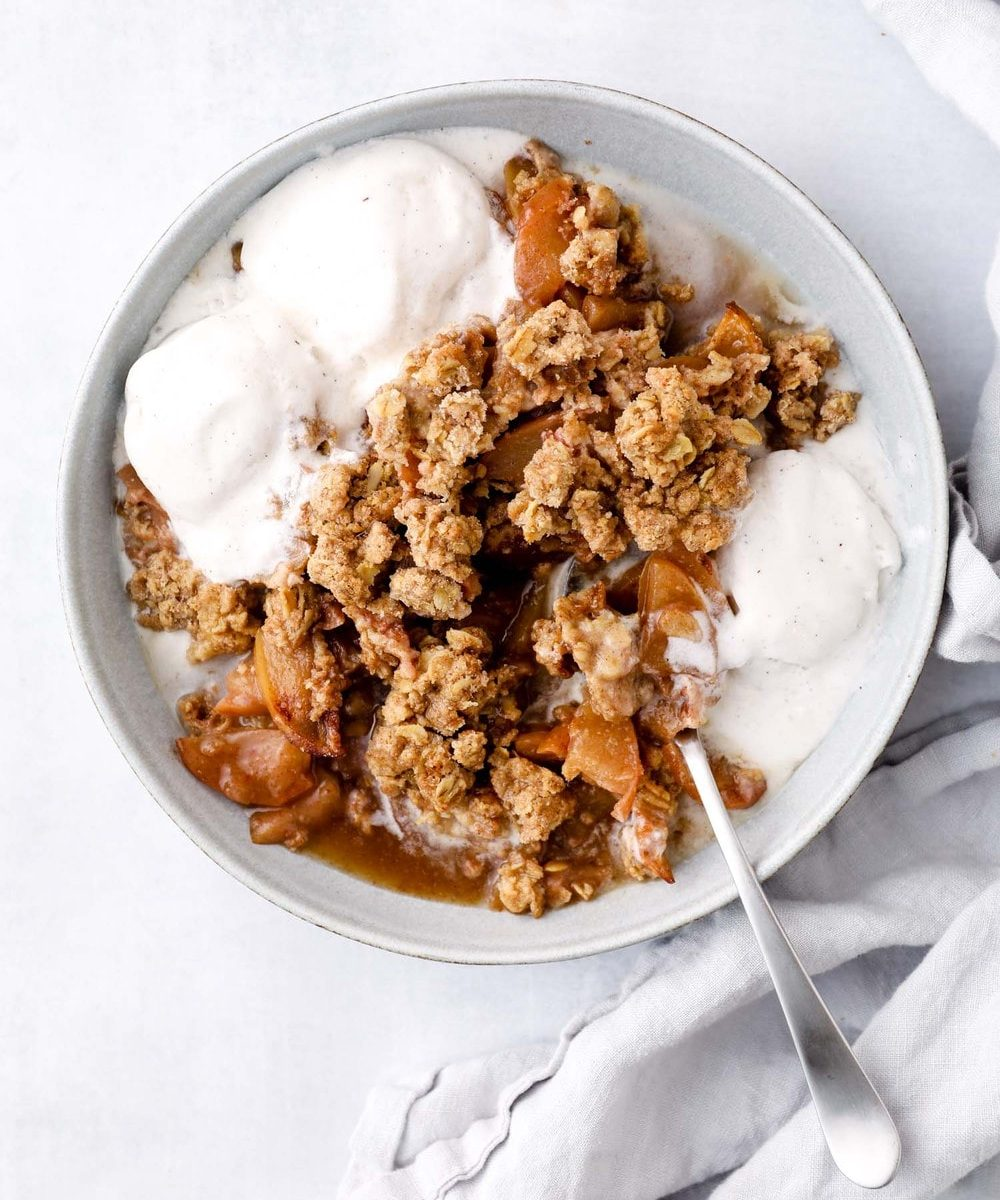 Gluten free apple crisp with oat crumble and vegan ice cream.