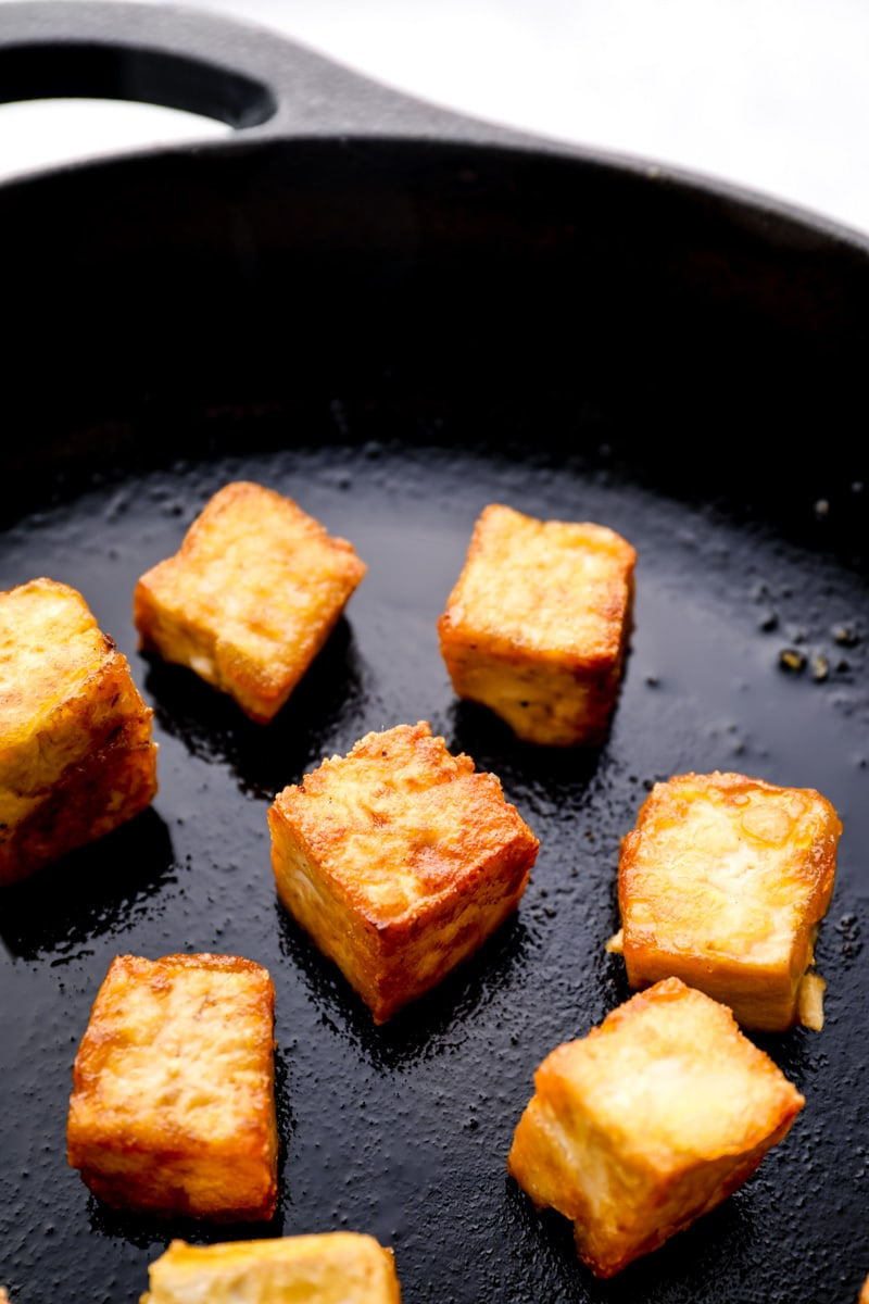 Crispy gluten free seared tofu in a skillet. Ready to add to General Tso's Tofu.