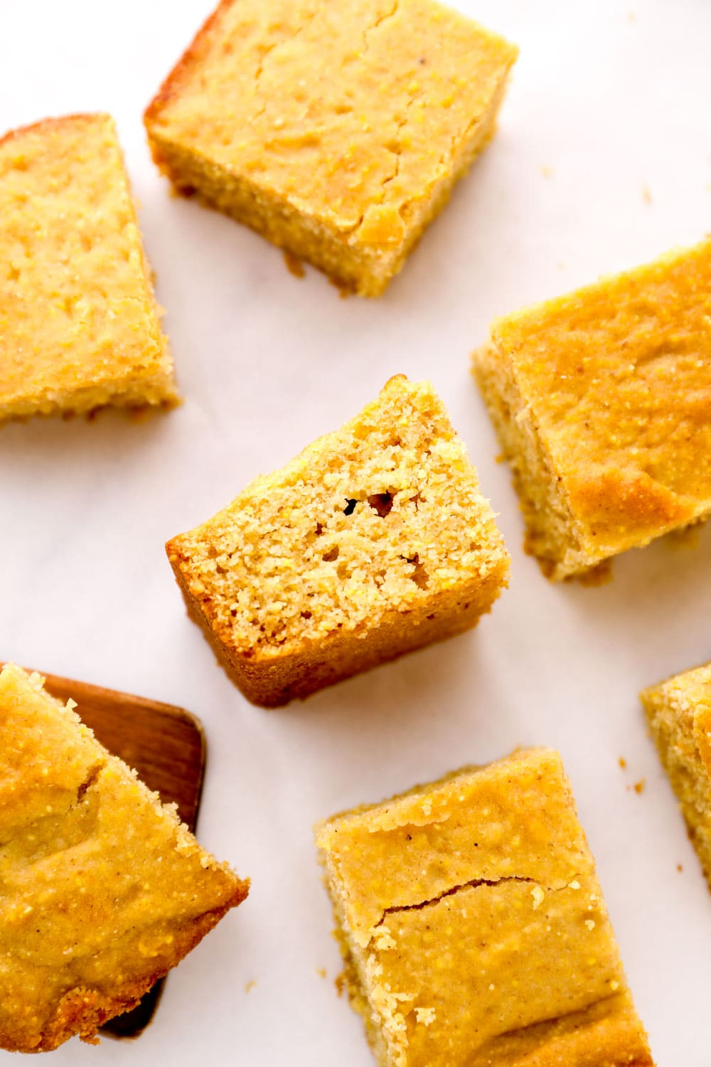 A sliced piece of Gluten Free Cornbread on its side so the crumb is visable.
