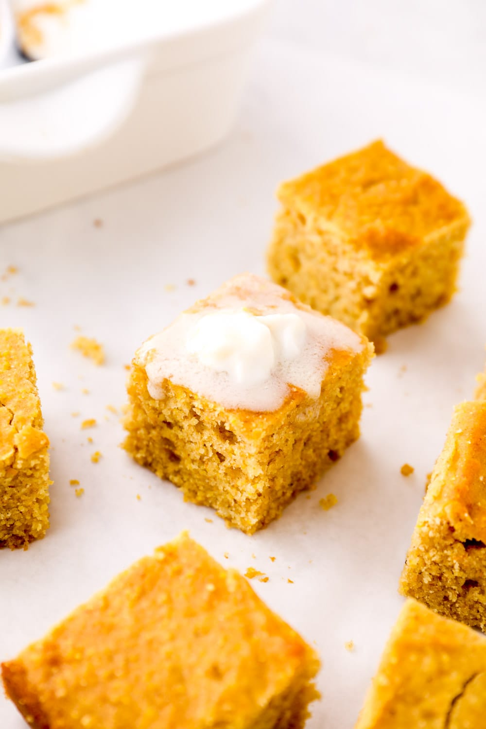 A slice of Gluten Free Cornbread with vegan butter melting on top.
