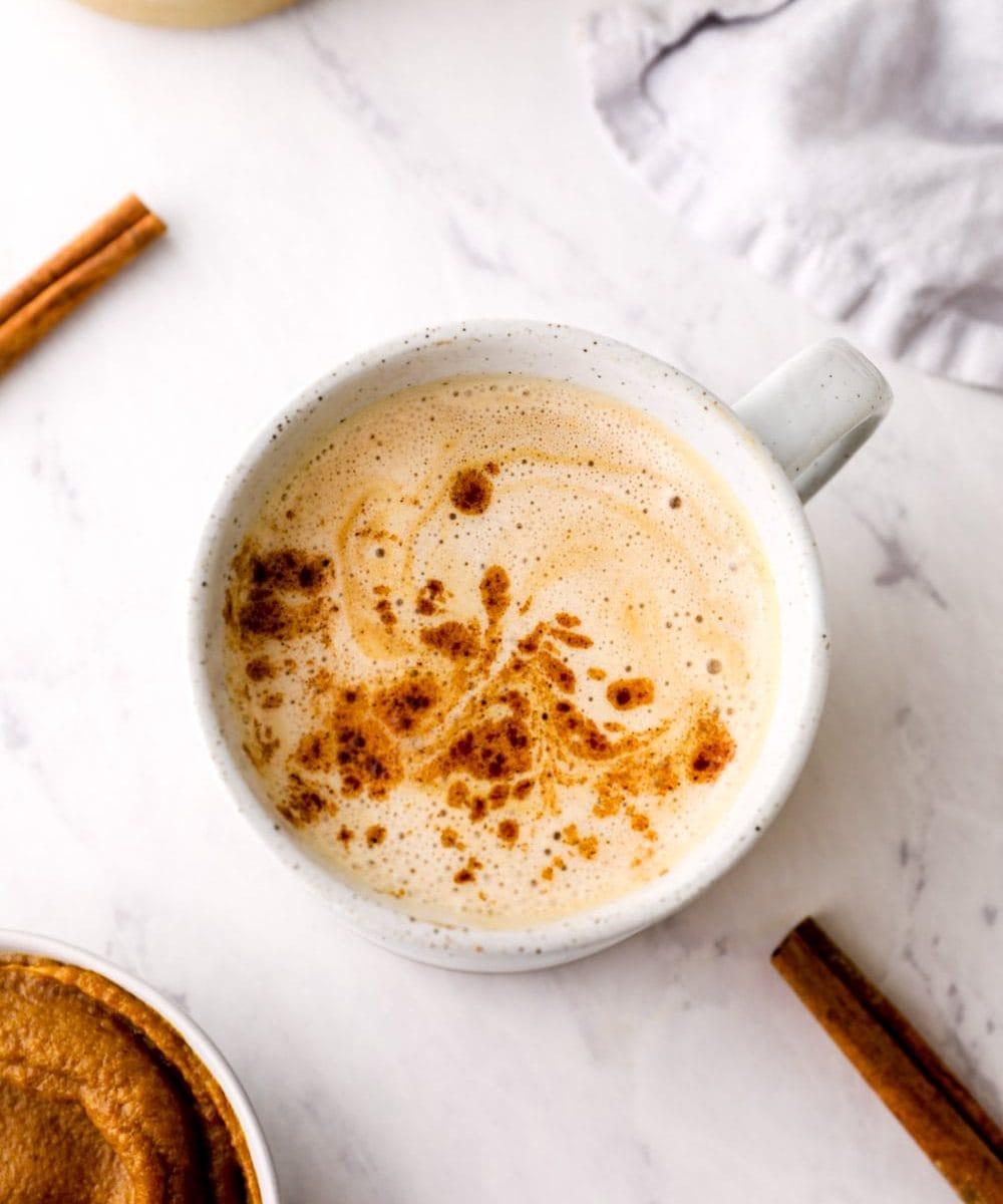 Caramel Pumpkin Spice Latte in a mug with cinnamon.