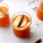 Hot Spiced Apple Cider with orange slices.