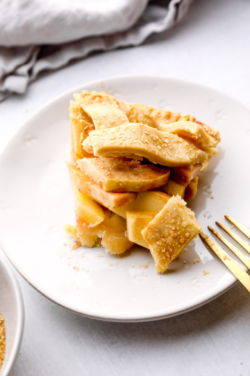 A bite out of a slice of Gluten Free Apple Pie.