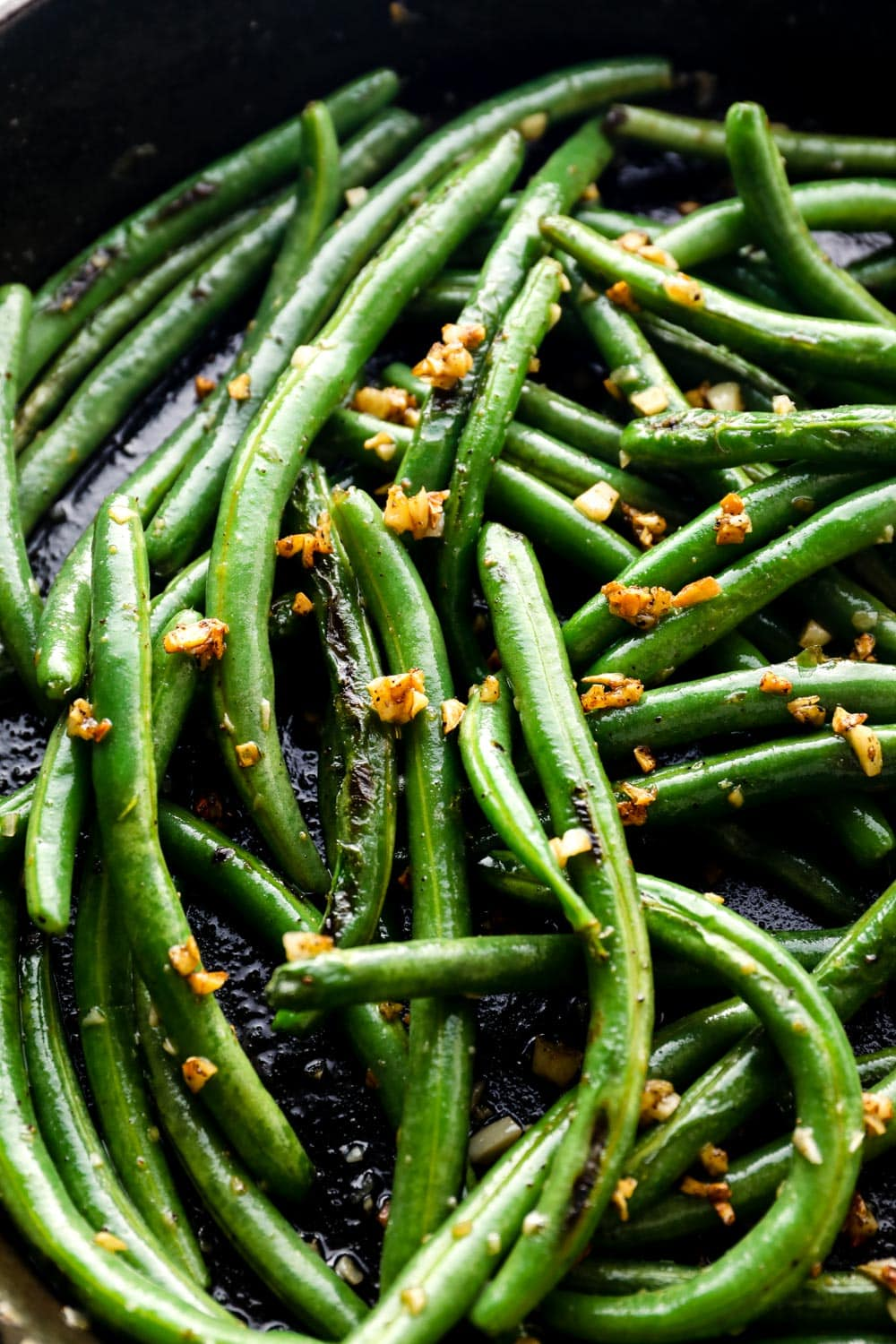 Green beans, sautéed in a cast iron skillet, with garlic.