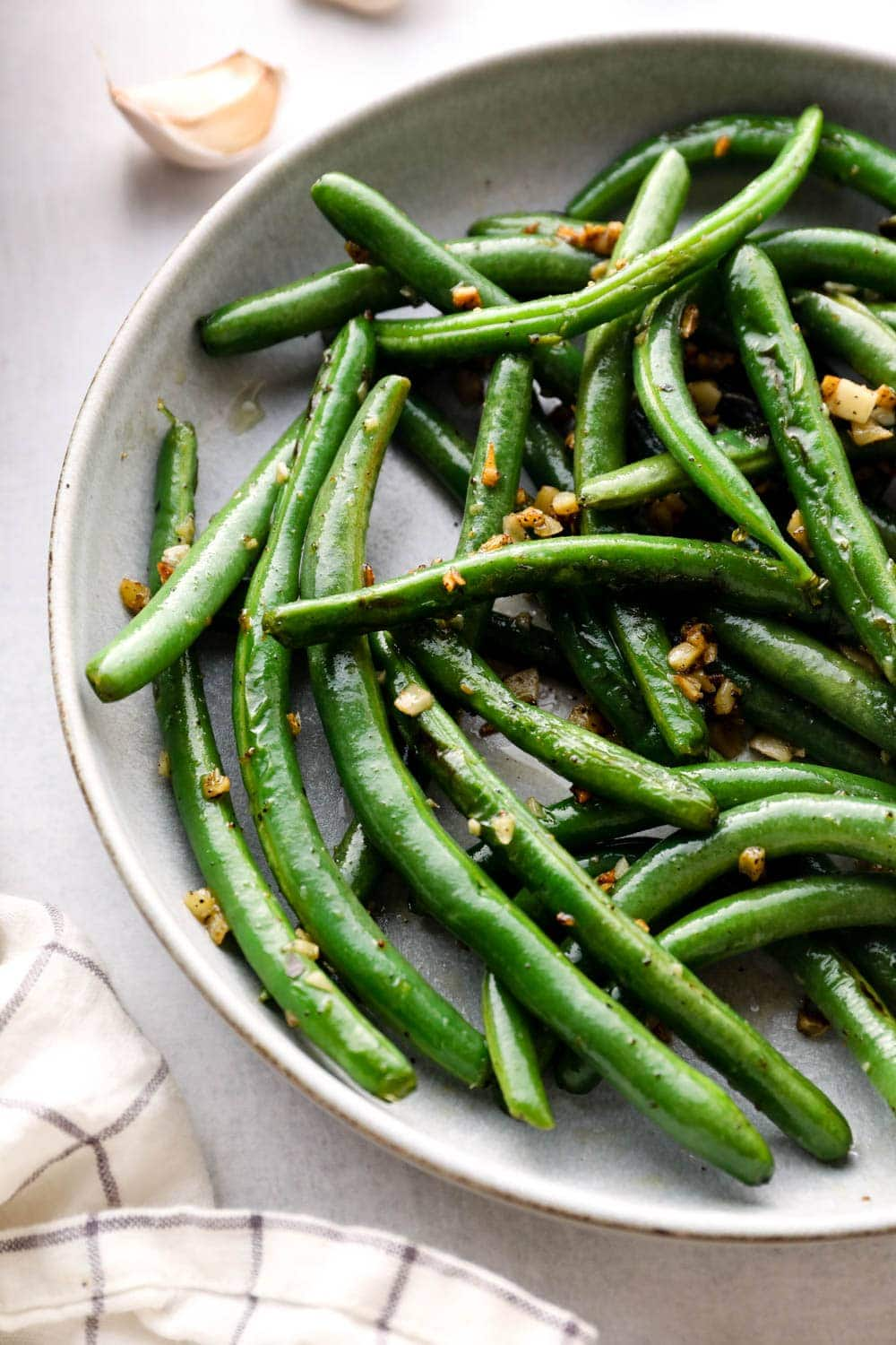 Sautéed green beans with crispy garlic.