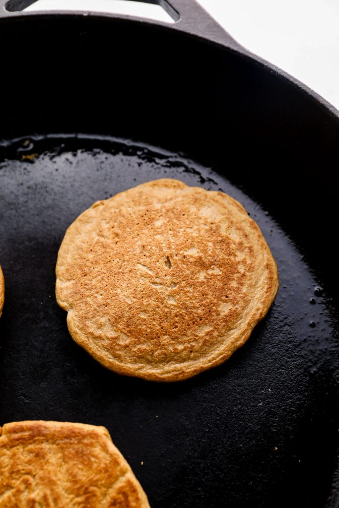 The cooked side of an Oat Flour Pancake in a skillet.