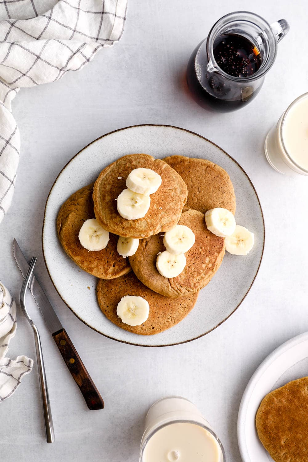 Oat Flour Pancakes on a plate with banana slices.