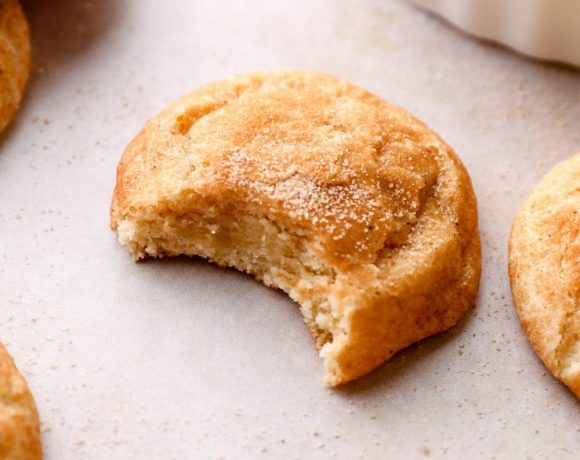 A bite out of a Gluten Free Snickerdoodle cookie.