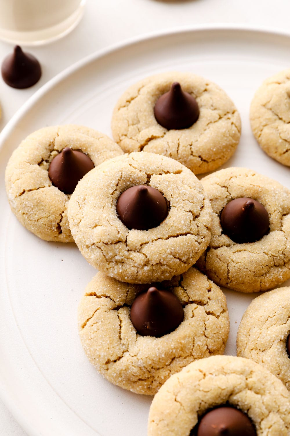 Gluten Free Peanut Butter Blossoms on a plate with dark chocolate.