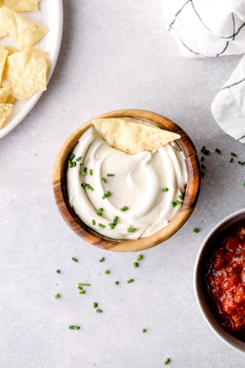 Cashew Sour Cream in a wooden bowl with chips.