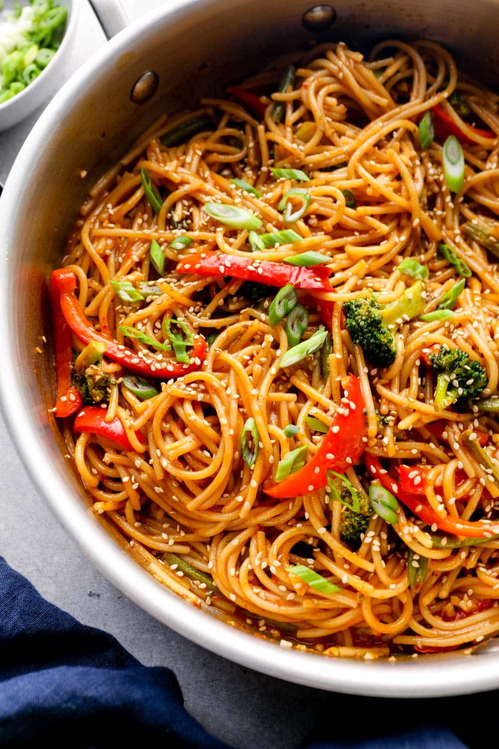 Pasta in a pan with veggies and gochujang sauce.