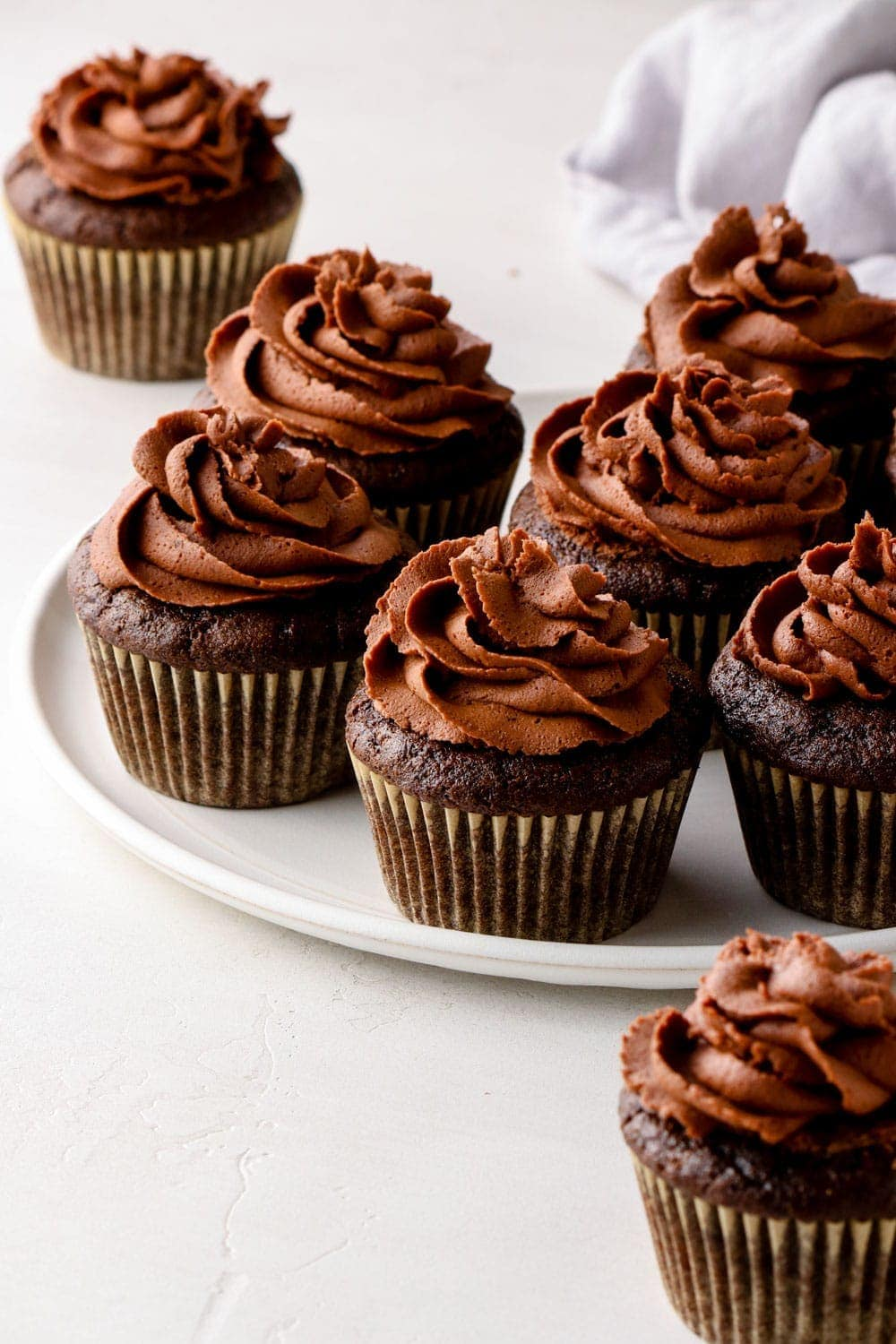 Chocolate cupcakes on a white plate.
