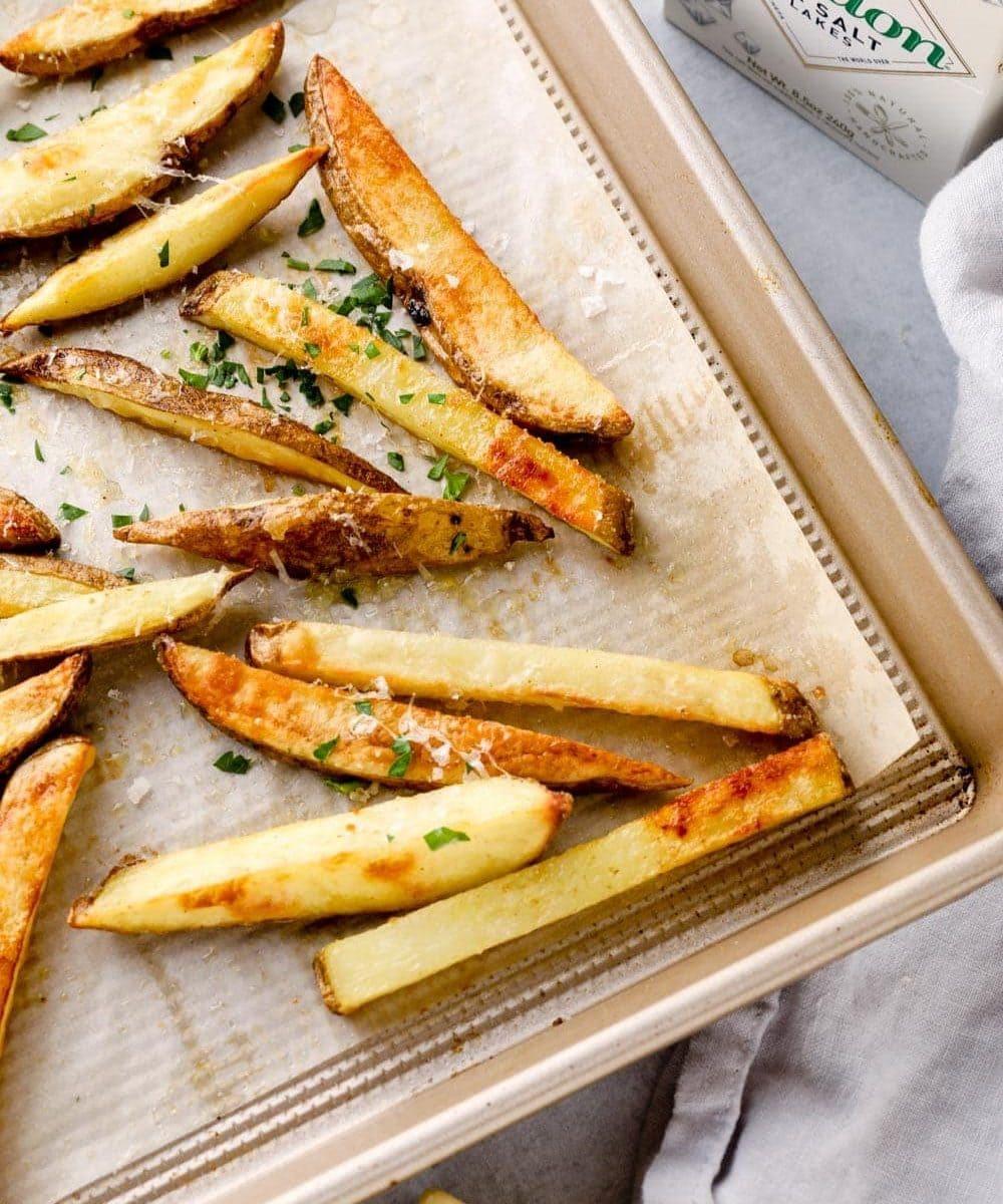 Truffle fries on a sheet pan with flaky maldon salt.