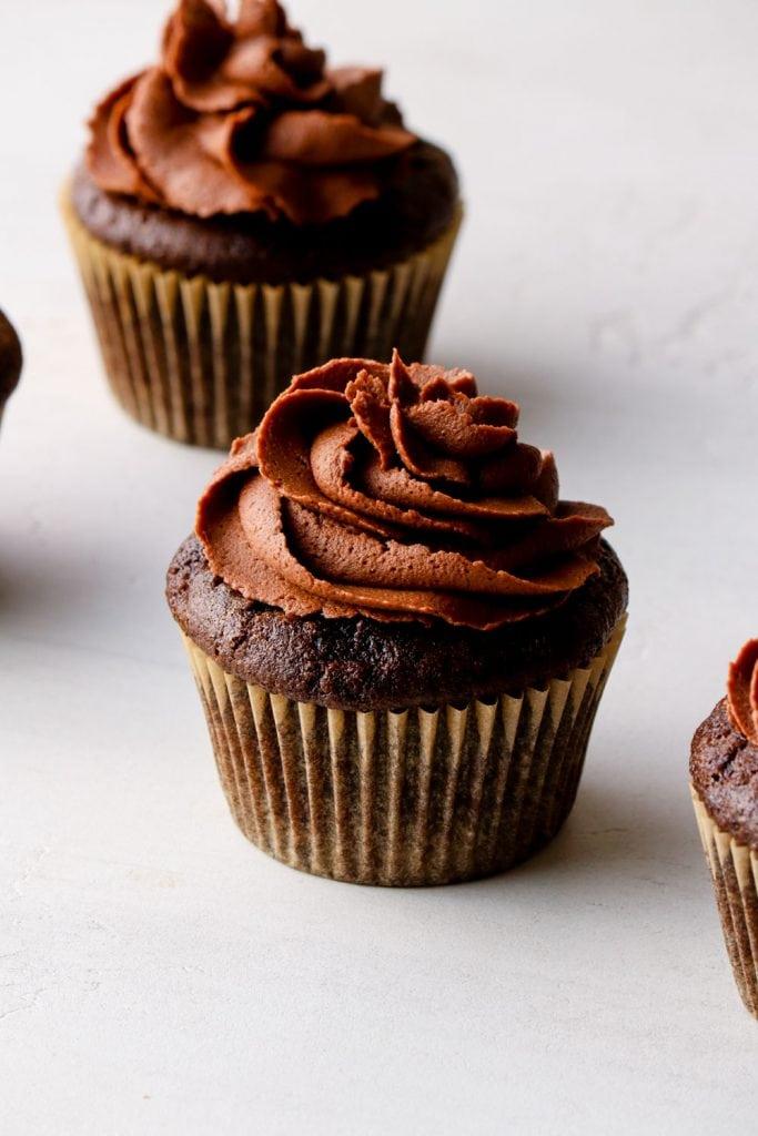 Vegan chocolate buttercream on a chocolate cupcake.