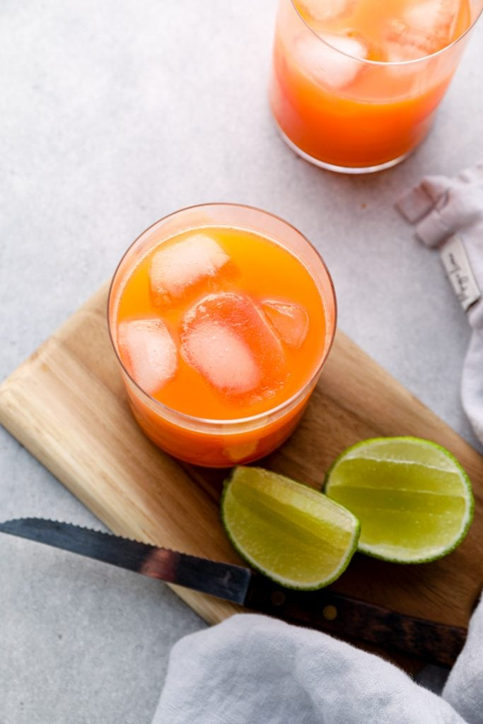 A glass of carrot orange lime juice.