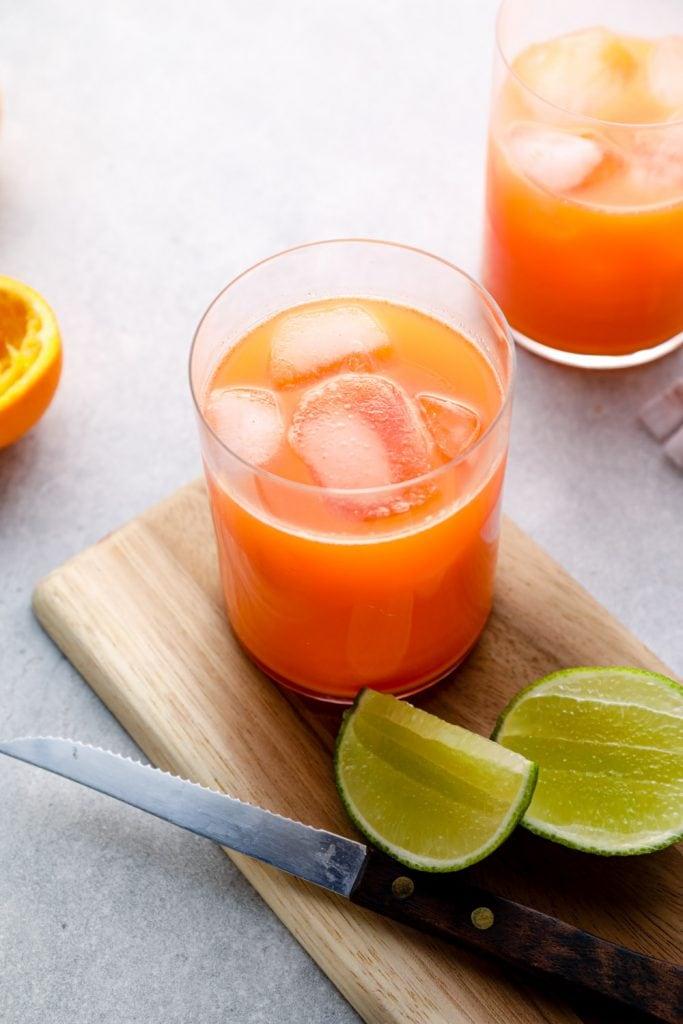 Carrot orange lime juice over ice.