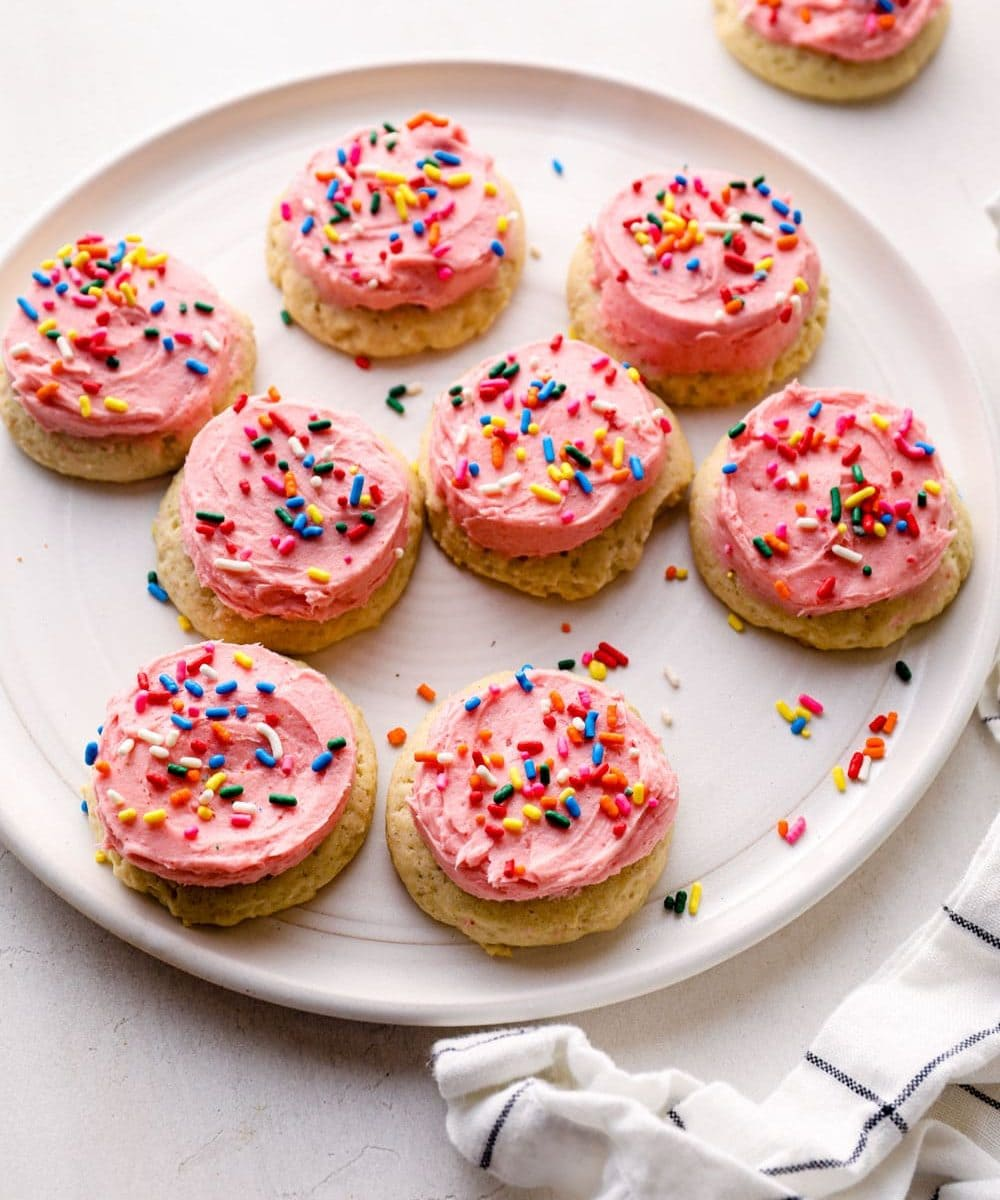 A plate of pink frosted sugar cookies.