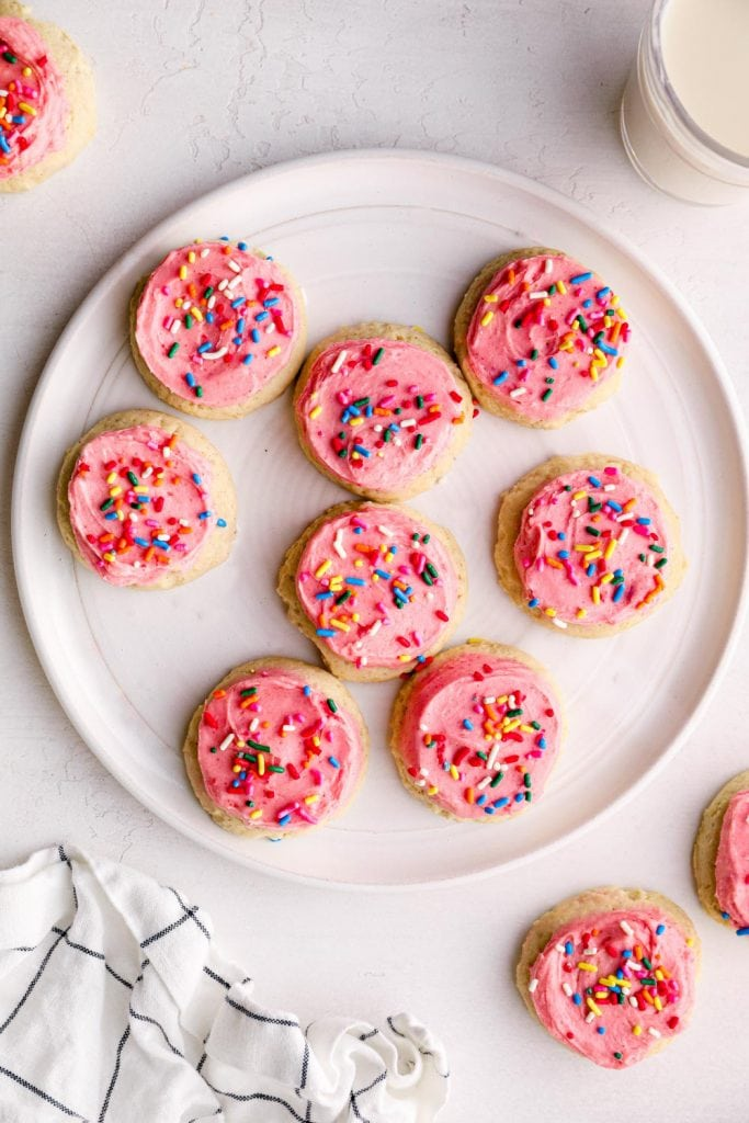 A white plate of gluten free sugar cookies.
