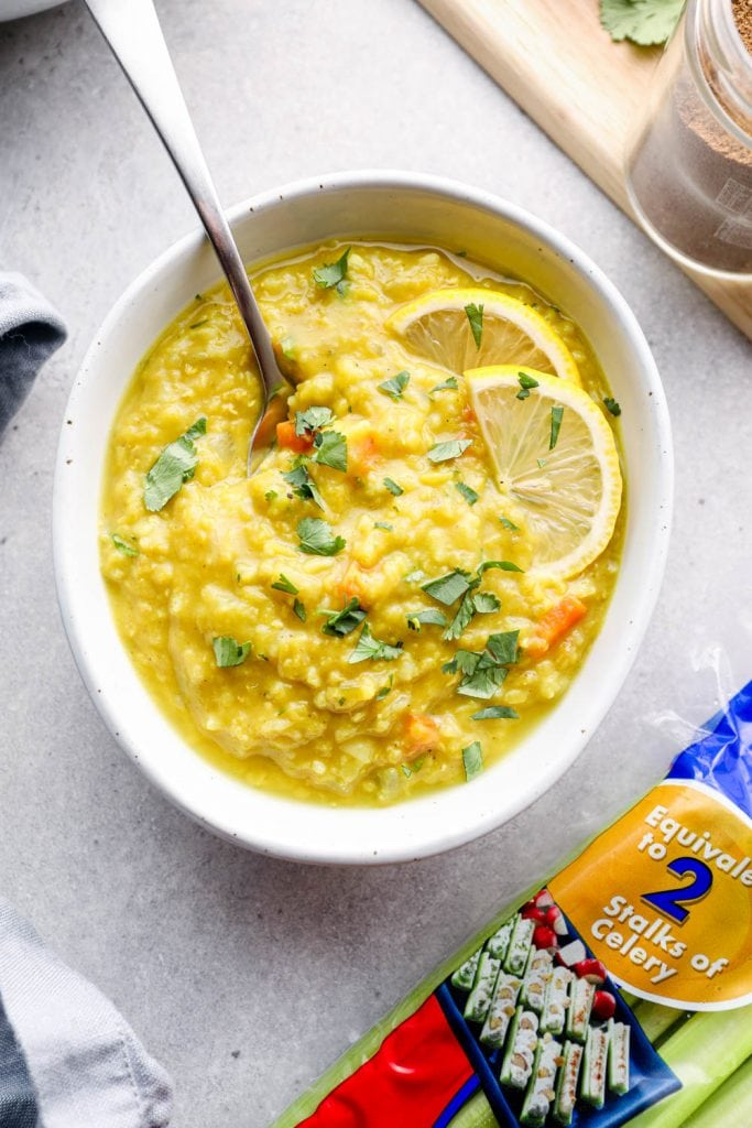 A spoon in a bowl of Lebanese lentil soup.