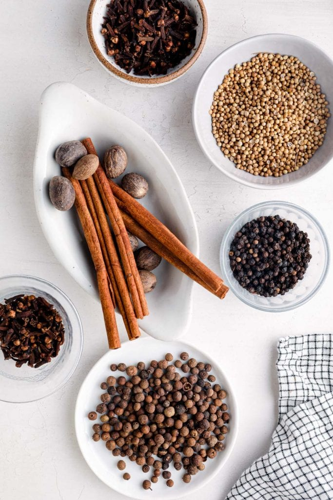 Whole spices in dishes.