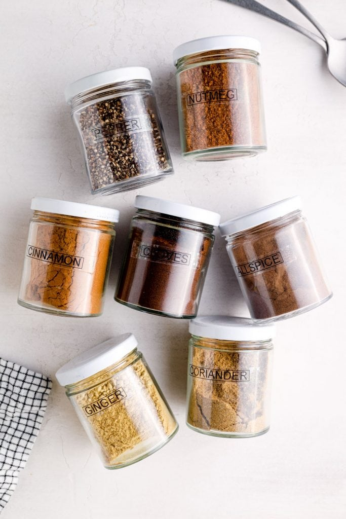 The spices needed to make 7 spice in jars.