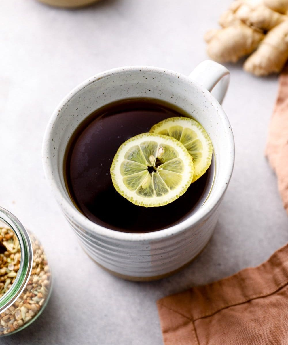 Healthy tea for digestion in a mug with lemon.